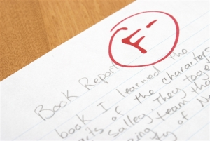A handwritten book report is given an F for poor work.
